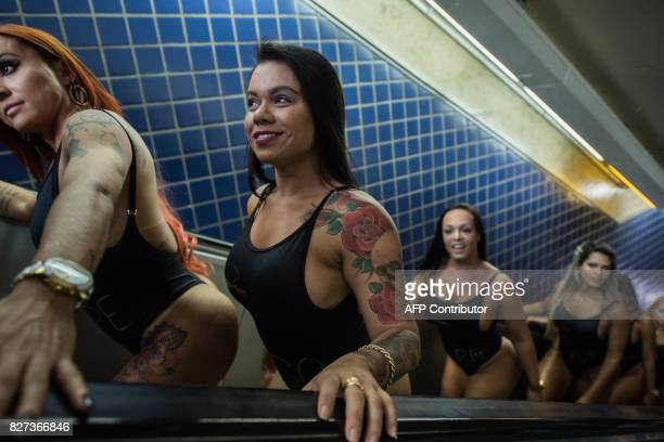 Models take part in the promotion of the Miss Bumbum beauty pageant at a subway station in Sao Paulo Brazil on August 7 2017 The annual Bumbum...