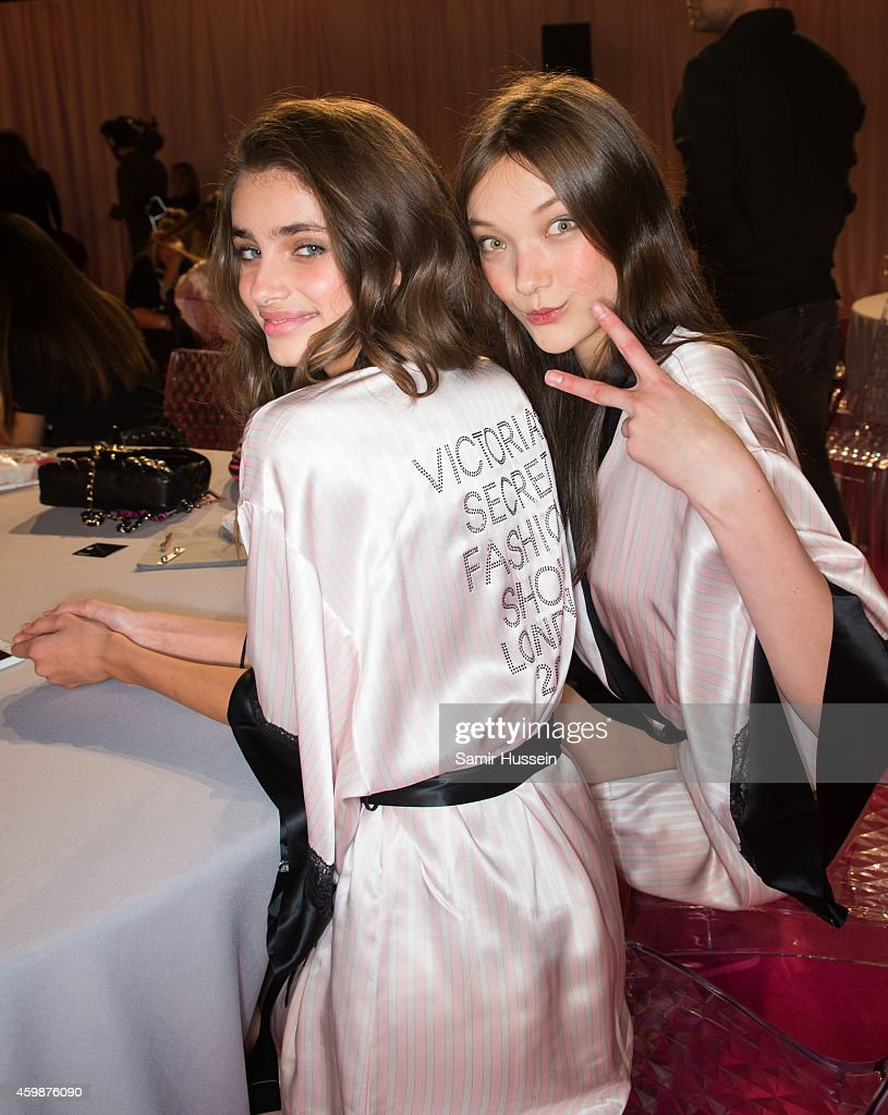 Models Taylor Hill (L) and <a gi-track='captionPersonalityLinkClicked' href=/galleries/search?phrase=Yumi+Lambert&family=editorial&specificpeople=10529076 ng-click='$event.stopPropagation()'>Yumi Lambert</a> pose backstage at the annual Victoria's Secret fashion show at Earls Court on December 2, 2014 in London, England.