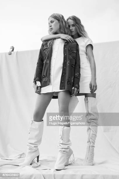 Models pose at a fashion shoot for Madame Figaro on June 30 2017 in Paris France Left Jacket shirt boots Right Dress boots PUBLISHED IMAGE CREDIT...