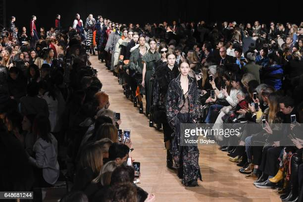 Models the runway during the finale of the Sacai show as part of the Paris Fashion Week Womenswear Fall/Winter 2017/2018 on March 6 2017 in Paris...