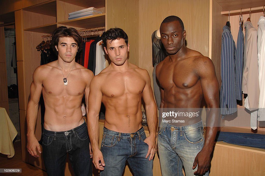 Models Tyler Phelan, Nick Pesola and Usnan Ojibara pose backstage at the Domenico Vacca Denim Preview at Domenico Vacca on July 15, 2010 in New York City.