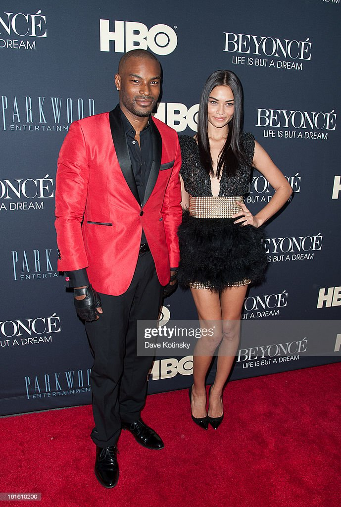 models <a gi-track='captionPersonalityLinkClicked' href=/galleries/search?phrase=Tyson+Beckford&family=editorial&specificpeople=210873 ng-click='$event.stopPropagation()'>Tyson Beckford</a> and model <a gi-track='captionPersonalityLinkClicked' href=/galleries/search?phrase=Shanina+Shaik&family=editorial&specificpeople=5556870 ng-click='$event.stopPropagation()'>Shanina Shaik</a> attend the 'Beyonce: Life Is But A Dream' New York Premiere at Ziegfeld Theater on February 12, 2013 in New York City.