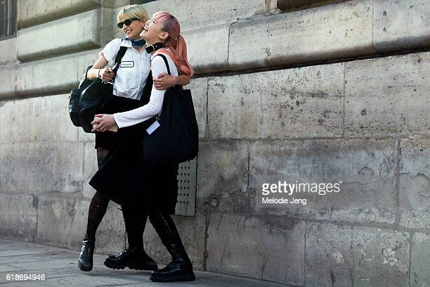 Models Veronika Vilim Fernanda Ly share a laugh and hug after the Courreges show on September 28 2016 in Paris France Veronika wears a Peels...