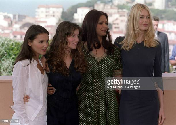 Models Virginie LeDoyen Laetitia Casta Diana Hayden and Claudia Schiffer at a photocall for L'Oreal products on the rooftop of the Palais des...