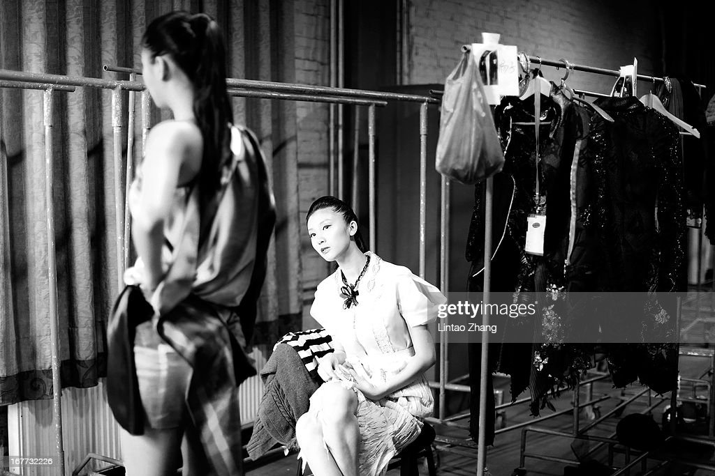Models wait backstage ahead of the First Master Training Camp Collection Show on the fifth day of China Graduate Fashion Week at 751D.PARK Central Hall on April 28, 2013 in Beijing, China.