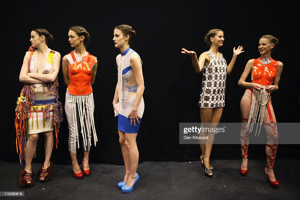 Models wait backstage during Graduate Fashion Week at Earls Court on June 6, 2011 in London, England. The event which began in 1991 showcases emerging talent from BA Graduate fashion design courses across the UK and includes exhibition stands and catwalk shows from around 50 universities.