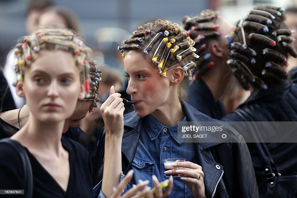 Models wait prior to the start of the Gosia Baczynska 2014 Spring/Summer ready-to-wear collection fashion show, on October 2, 2013 in Paris.