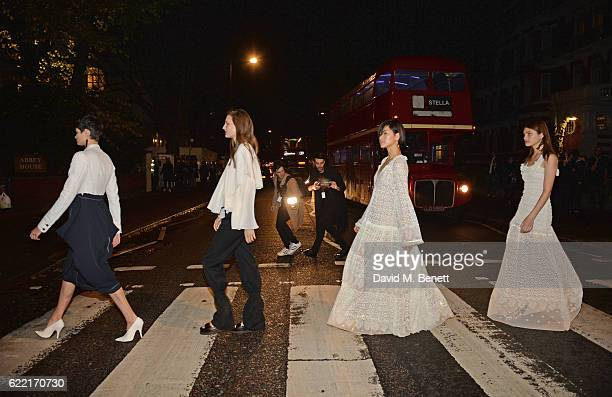 Models walk across Abbey Road to the Stella McCartney Menswear launch and Women's Spring 2017 collection presentation at Abbey Road Studios on...