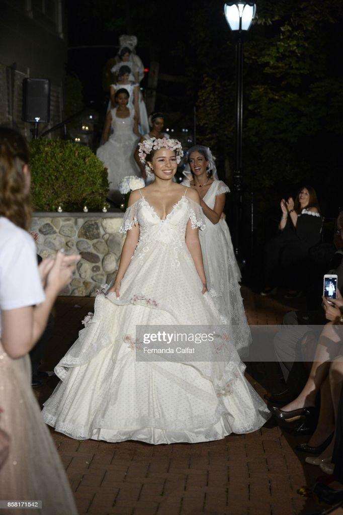 Models walk at Po de Arroz Runway at New York Fashion Week Bridal October 2017 at Hendrick's Tavern on October 5, 2017 in Roslyn, New York.