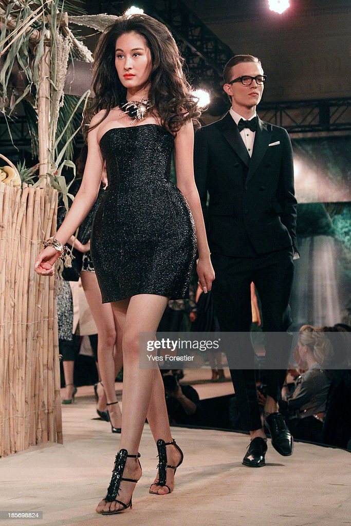 Models walk down the catwalk during the Dsquared2 fashion show at Hotel International Tashkent on October 23, 2013 in Tashkent, Uzbekistan.