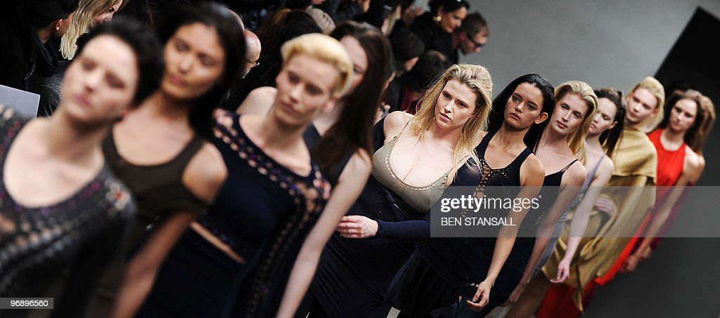 Models walk down the catwalk wearing clothes by Mark Fast for the Autumn/Winter 2010 collection on the second day of the London Fashion Week in...