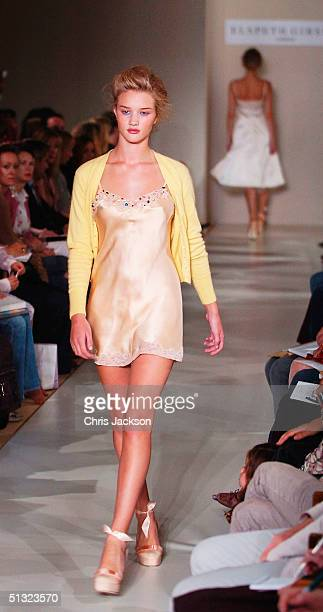Models walk down the runway at the Elspeth Gibson fashion show as part of London Fashion Week Spring/Summer 2005 at Kent House on September 19 2004...