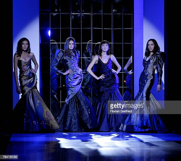 Models walk down the runway at the Unrath Strano show part of the Mercedes Benz Fashion Week at Postbahnhof on January 30 2008 in Berlin Germany