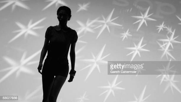 Models walk down the runway at the Winchester School of Art fashion show on day two of Graduate Fashion Week at Battersea Park on June 6 2005 in...
