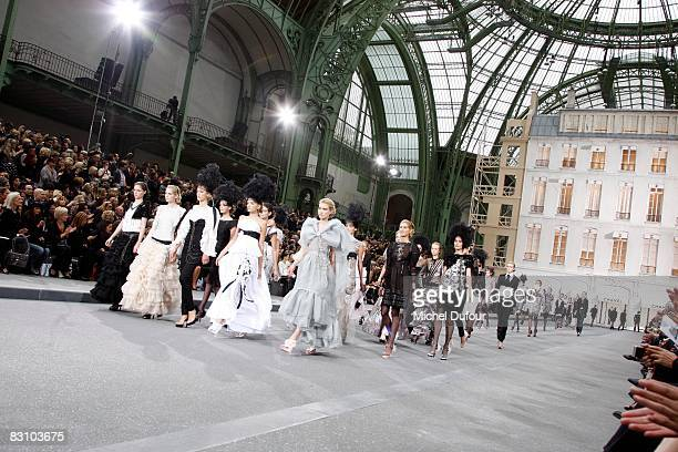 Models walk down the runway during the Chanel PFW Spring Summer 2009 show at Paris Fashion Week 2008 at Grand Palais on October 3 2008 in Paris France