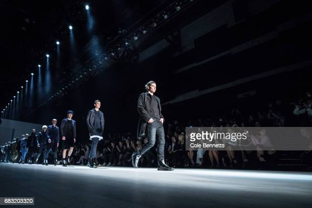 Models walk down the runway during the Justin Cassin show at MercedesBenz Fashion Week Resort 18 Collections at Carriageworks on May 15 2017 in...