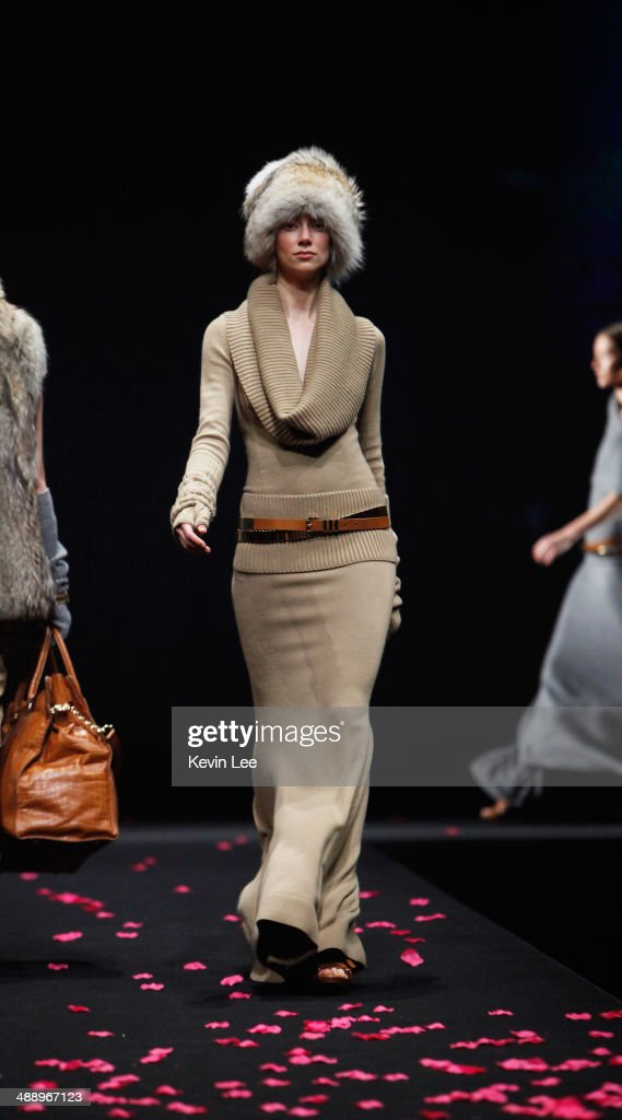 Models walk on catwalk during The Michael Kors Jet Set Experience fashion show on May 9, 2014 in Shanghai, China.