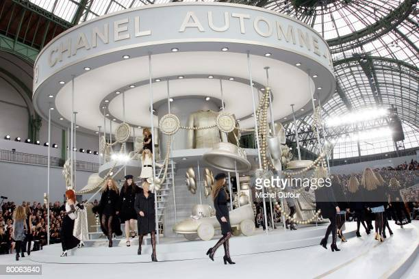 Models walk on the catwalk at the Chanel Fashion show during Paris Fashion Week FallWinter 20082009 at the Grand Palais on February 29th 2008 in...