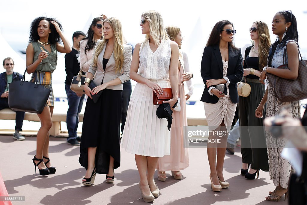 Models walk on the Croisette on May 16 2013 during the 66th edition of the Cannes Film Festival in Cannes AFP PHOTO / VALERY HACHE