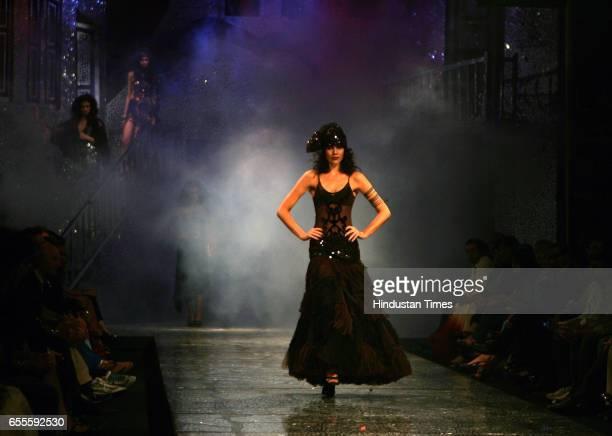 Models walk on the ramp during designer Sumeet Verma Creation at Day Five of Lakme Fashion Week Summer Resort Collection 2010 at Mumba