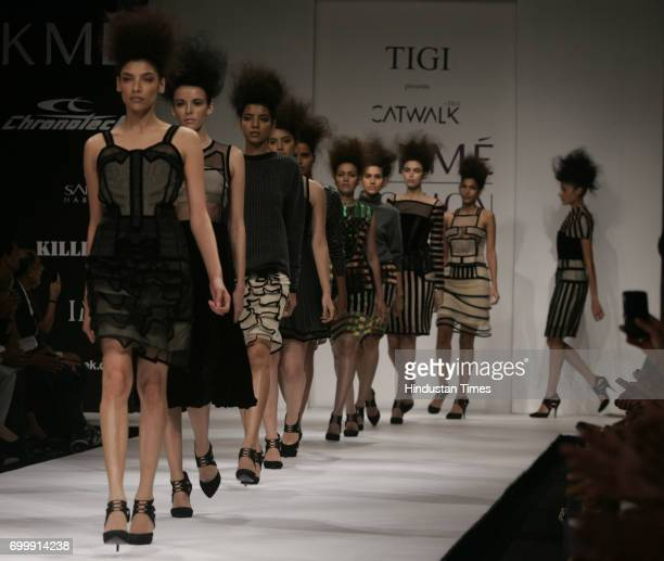 Models walk on the ramp during designer TIGI Catwalk by Christopher Kane and Anthony Mascolo Creation at Day Five of Lakme Fashion Week Summer Resort...