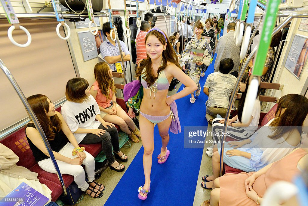 Models walk on the runway during the 'Chikatetsu (Subway) Collection', held in carriages of Osaka city subway Midosuji Line on July 7, 2013 in Osaka, Japan. The fashion show is held to celebrate the 80th anniversary of the subway Midosuji Line.