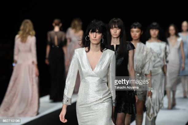 Models walk on the runway during the TAE ASHIDA show as part of Amazon Fashion Week Tokyo 2018 S/S at Grand Hyatt Tokyo on October 18 2017 in Tokyo...