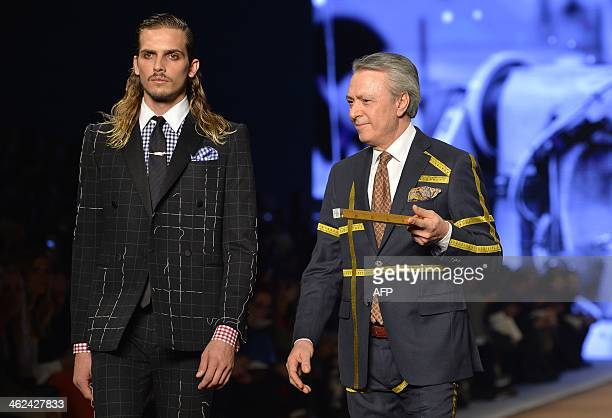 Models walk on the runway with dressmakers and tailors at the end of the show for fashion house Etro as part of Autumn/Winter 2014 Milan Collections...