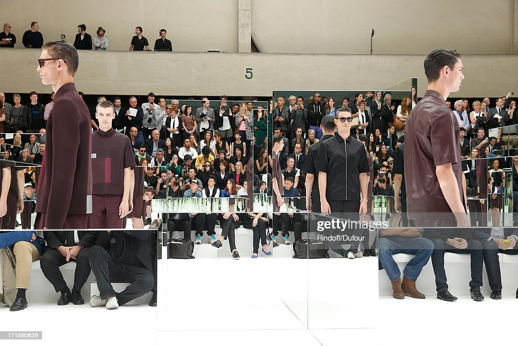 Models walk th catwalk at Dior Homme Menswear Spring/Summer 2014 Show as part of the Paris Fashion Week on June 29, 2013 in Paris, France.