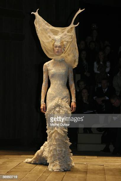 Models walk the catwalk at the Alexander McQueen fashion show at Paris Fashion Week Autumn/Winter 2006/7 on March 3 2006 in Paris France