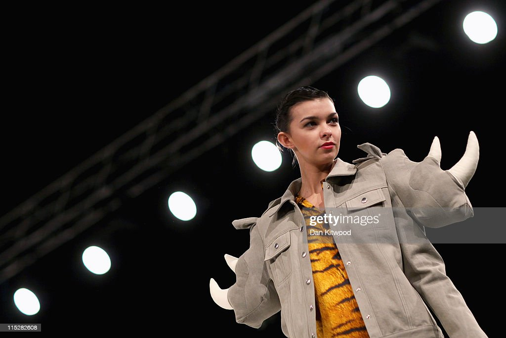 Models walk the catwalk during Graduate Fashion Week at Earls Court on June 6, 2011 in London, England. The event which began in 1991 showcases emerging talent from BA Graduate fashion design courses across the UK and includes exhibition stands and catwalk shows from around 50 universities.
