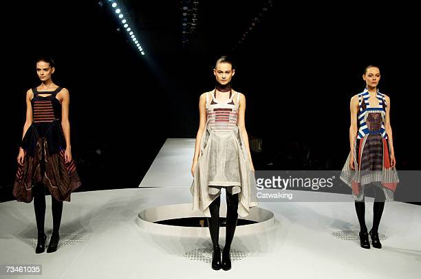 Models walk the catwalk during the Hussein Chalayan fashion show as part of Paris Fashion Week Autumn/Winter 2008 on February 28 2007 in Paris France