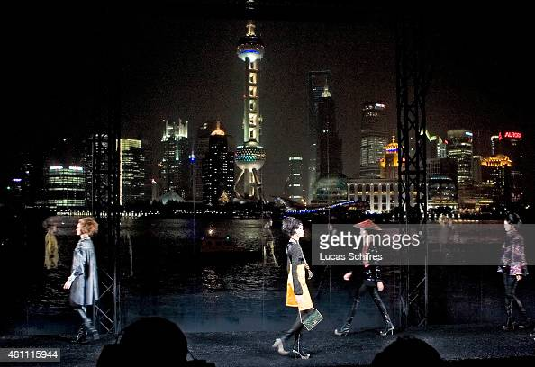 Models walk the catwalk in front of the famous Shanghai Pudong panorama at Chanel Fashion Show on December 3 2009 in Shanghai China