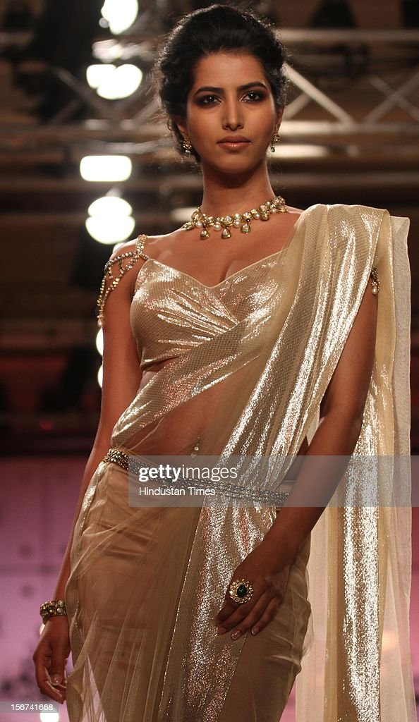 'NEW DELHI, INDIA - AUGUST 9: Models walk the ramp for Indian designers Asheema and Leena show during the second day of on going couture week at Taj Palace on August 9, 2012 in New Delhi, India. (Photo by Jasjeet Plaha/Hindustan Times via Getty Images)'