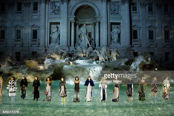 Models walk the runway at Fendi Roma 90 Years Anniversary fashion show at Fontana di Trevi on July 7 2016 in Rome Italy