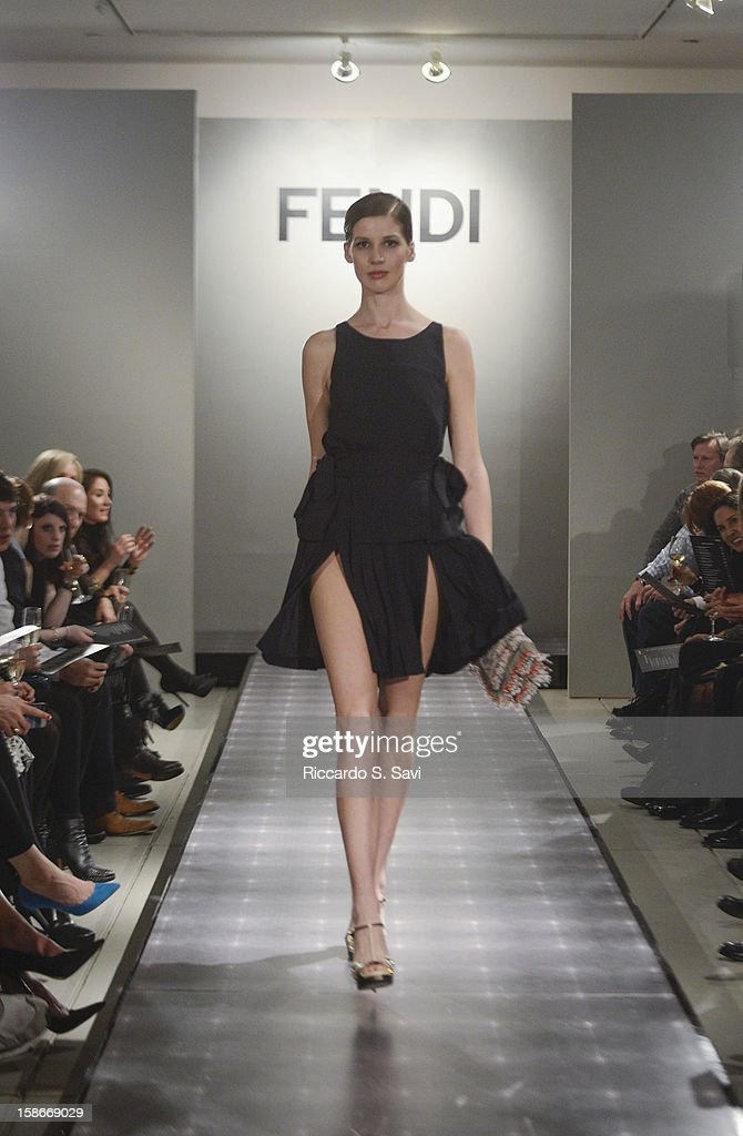 Models walk the runway at Fendi with Vogue and Angie Stewart, Carolyn Powers, Mona Look-Mazza And Richard Edwards host an exclusive celebration of the Fendi Resort 2013 Collection at Baldwin Gallery on December 22, 2012 in Aspen, Colorado.