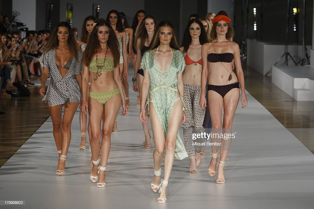 Models walk the runway at Guillermina Baeza's Spring-Summer 2014 Collection during 080 Barcelona Fashion Week on July 11, 2013 in Barcelona, Spain.