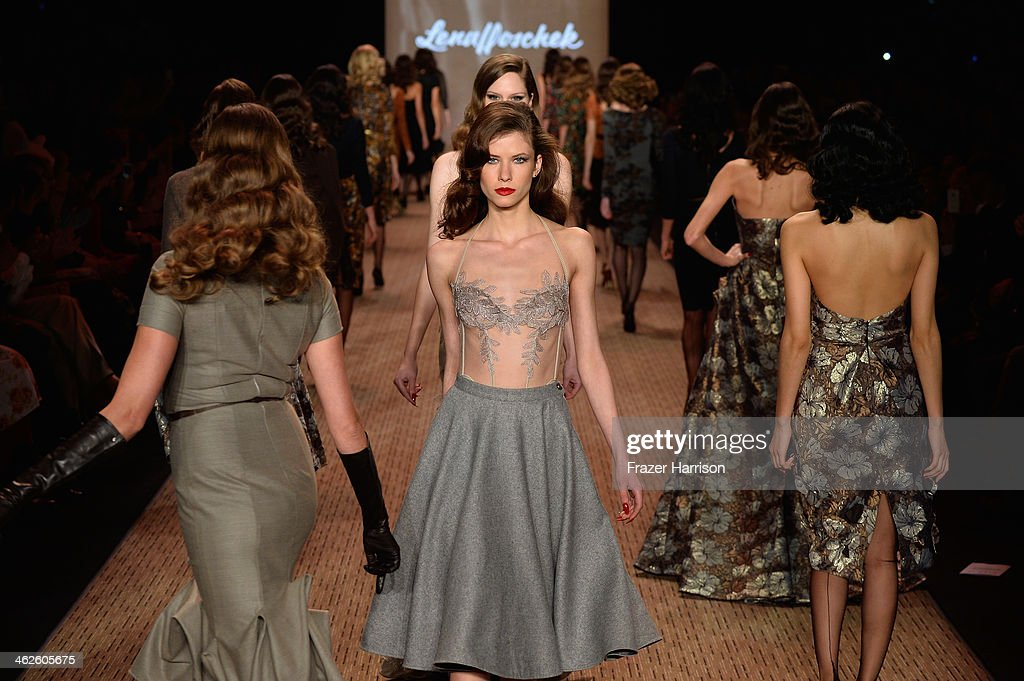 Models walk the runway at Lena Hoschek show during Mercedes-Benz Fashion Week Autumn/Winter 2014/15 at Brandenburg Gate on January 14, 2014 in Berlin, Germany.