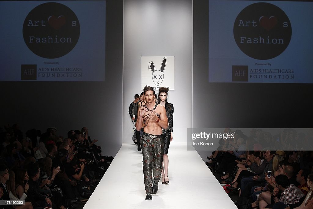 Models walk the runway at Mister Triple X fashion show during Style Fashion Week - Day 3 at L.A. Live Event Deck on March 11, 2014 in Los Angeles, California.