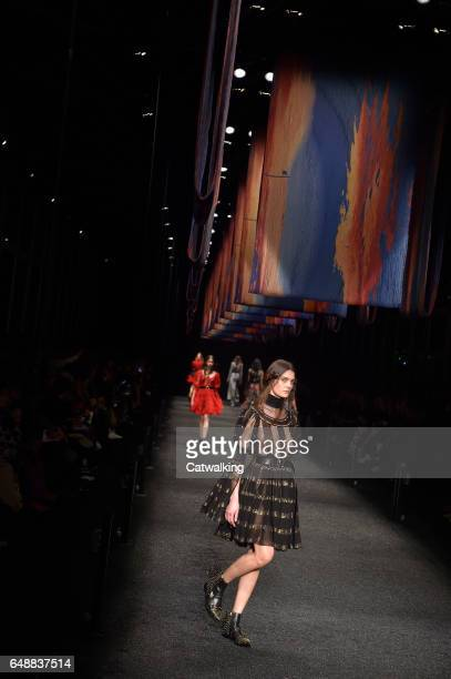 Models walk the runway at the Alexander McQueen Autumn Winter 2017 fashion show during Paris Fashion Week on March 6 2017 in Paris France