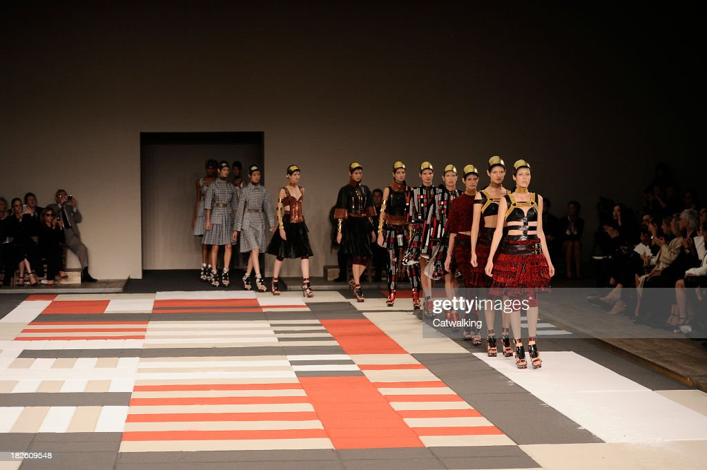 Models walk the runway at the Alexander McQueen Spring Summer 2014 fashion show during Paris Fashion Week on October 1, 2013 in Paris, France.