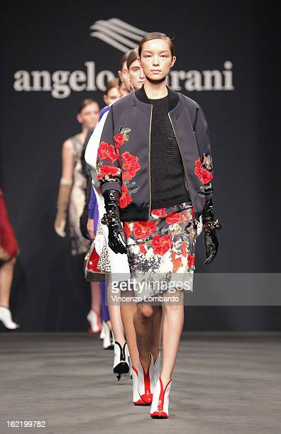 Models walk the runway at the Angelo Marani fashion show as part of Milan Fashion Week Womenswear Fall/Winter 2013/14 on February 20 2013 in Milan...