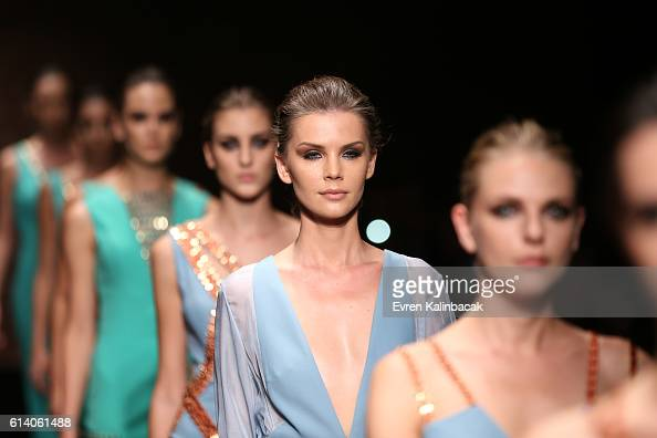 Models walk the runway at the Aslialev show during MercedesBenz Fashion Week Istanbul at Zorlu Center on October 11 2016 in Istanbul Turkey