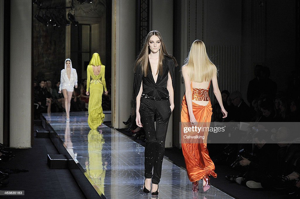 Models walk the runway at the Atelier Versace Spring Summer 2014 fashion show during Paris Haute Couture Fashion Week on January 19, 2014 in Paris, France.