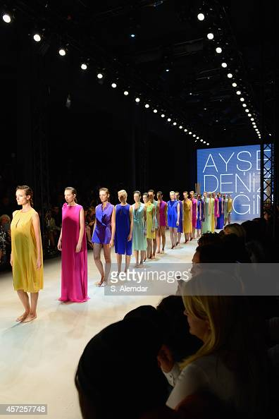 Models walk the runway at the Ayse Deniz Yegin show during Mercedes Benz Fashion Week Istanbul SS15 at Antrepo 3 on October 15 2014 in Istanbul Turkey