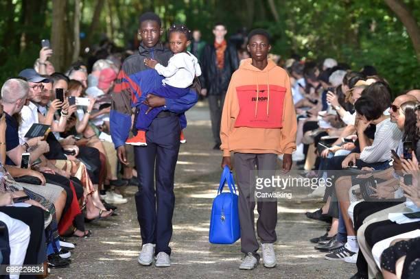 Models walk the runway at the Balenciaga Spring Summer 2018 fashion show during Paris Menswear Fashion Week on June 21 2017 in Paris France