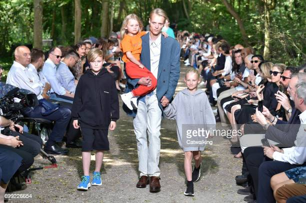 Models walk the runway at the Balenciaga Spring Summer 2018 fashion show during Paris Menswear Fashion Week on June 21 2017 in Paris France