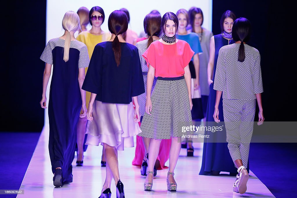 Models walk the runway at the Biryzkov show during Mercedes-Benz Fashion Week Russia S/S 2014 on October 28, 2013 in Moscow, Russia.