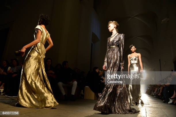 Models walk the runway at the Bottega Veneta Autumn Winter 2017 fashion show during Milan Fashion Week on February 25 2017 in Milan Italy