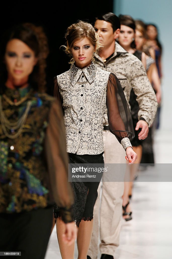 Models walk the runway at the Bunker Z show during Mercedes-Benz Fashion Week Russia S/S 2014 on October 31, 2013 in Moscow, Russia.
